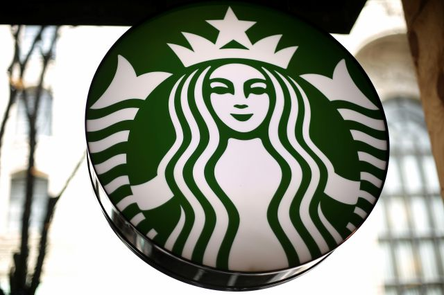 FILE - This Saturday, March 24, 2018, file photo, shows a sign at a Starbucks in the U.S. Starbucks is expanding its delivery service and aims to offer it at nearly one-fourth of its U.S. company-operated coffee shops. (AP Photo/Gene J. Puskar, File)