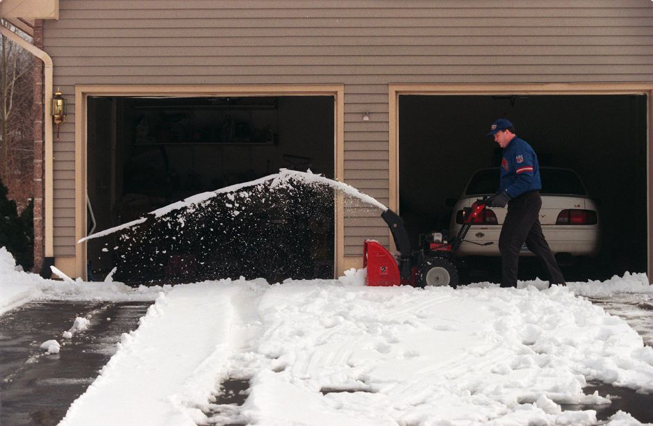 RJ file photo - Gerald Nickodemski uses a snow blower to remove the snow from his Canterbury Lane driveway in Southington March 15, 1999.