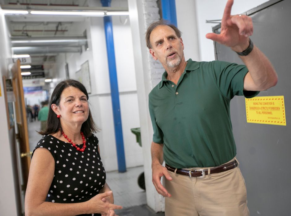 Democratic congressional candidate Mary Glassman, of Simsbury, talks with Jonal Labs Inc. President, Marc Nemeth, in Meriden, Tuesday, August 7, 2018. Glassman spent the day reaching out to voters one week before Tuesday's primary election. Dave Zajac, Record-Journal