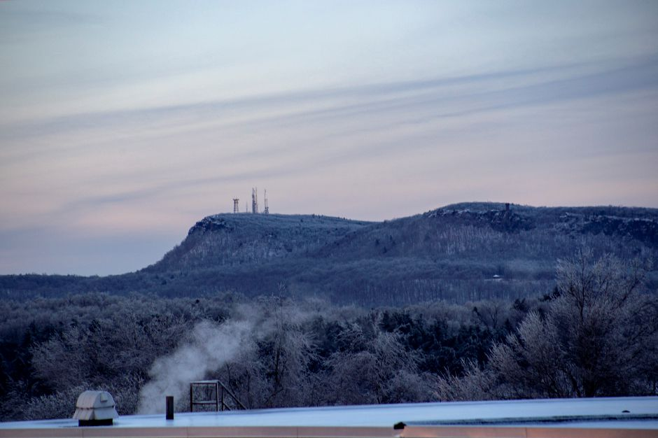 Looking over a landscape of ice towards the hanging hills and Castle Craig in Meriden Jan. 22, 2019. | Richie Rathsack, Record-Journal