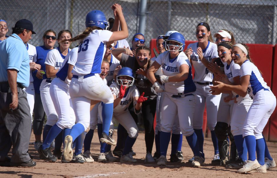 Gabby Verderame-Malachowski is greated by her teammates after belting a three-run homer in the third inning of Monday's Class LL state softball semifinal against Trumbull at DeLuca Field in Stratford. Southington won 5-1. Photos by Spencer Davis, Record Journal