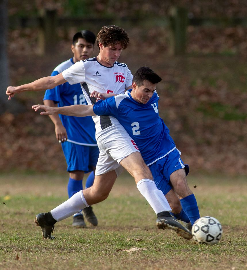 Nathan DeMaio, right, tries to shield the ball from Masuk's Kyle Anderson during Wilcox Tech's 2-0 loss in  the first round of the CIAC Class L boys soccer tournament at Wilcox Tech in Meriden on Monday.  Aaron Flaum, Record-Journal