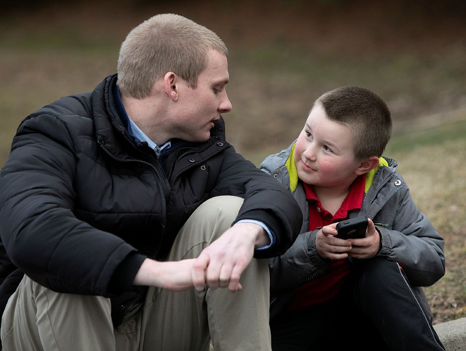 Devan McAdams, 7, of Meriden, talks with Big Brother Jeff Dalrymple, of Middletown, while playing Pokémon GO on his phone, Thurs., Mar. 28, 2019. Dalrymple is a Big Brother with Nutmeg Big Brothers Big Sisters. Dave Zajac, Record-Journal