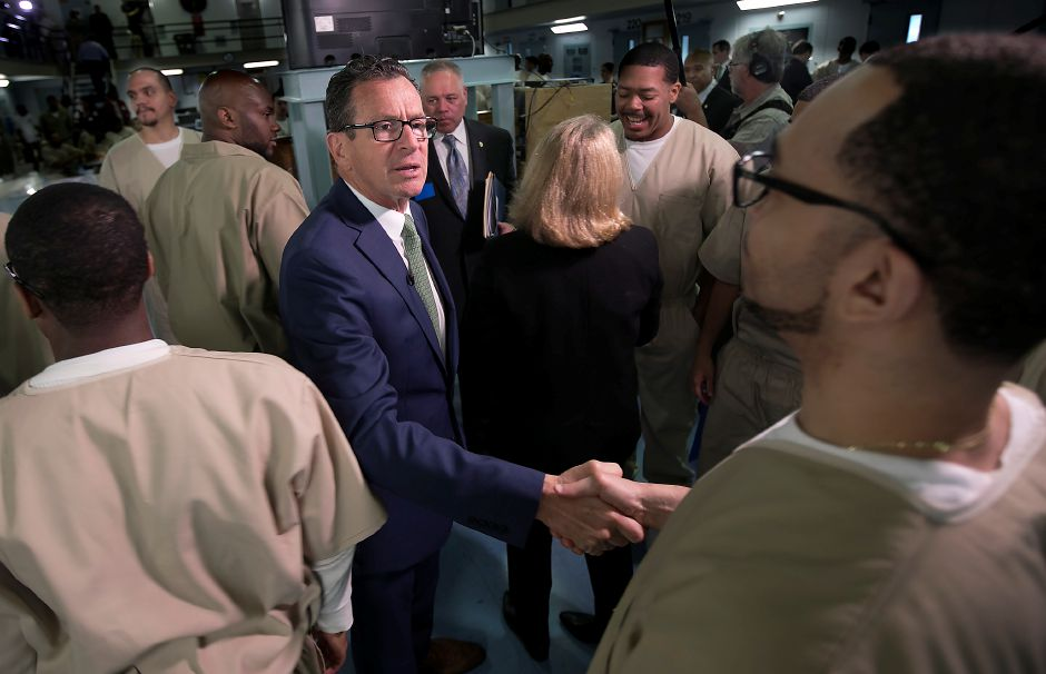 Governor Dannel P. Malloy greets inmate Caesar Oneil, 41, of Bridgeport, while touring the Cheshire Correctional Institution, Wednesday, May 30, 2018. Dave Zajac, Record-Journal