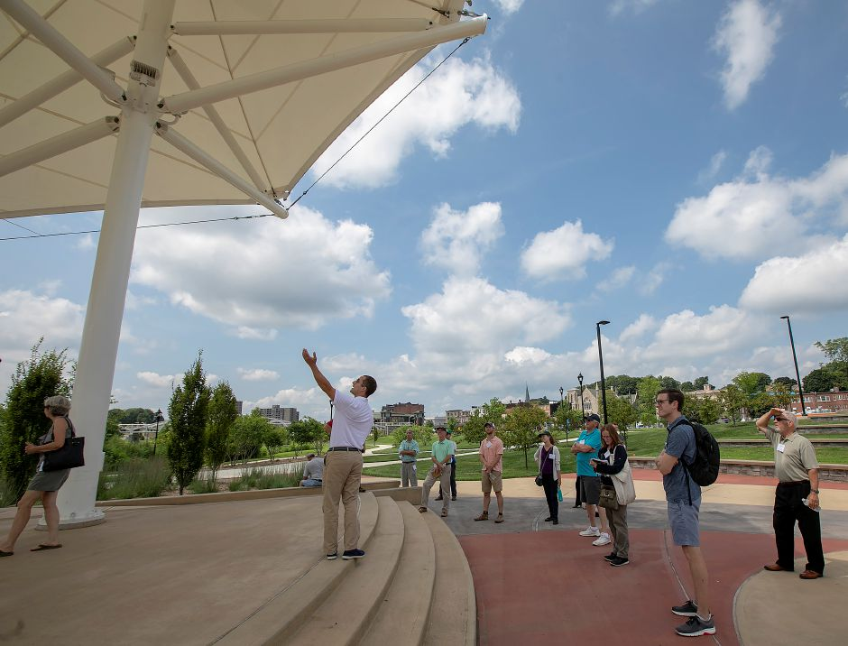 Milone & MacBroom Lead Landscape Architect Ryan Chmielewski, center, talks about the amphitheatre while leading members of the American Society of Landscape Architects on a tour of the Meriden Green, Wednesday, August 8, 2018. Dave Zajac, Record-Journal
