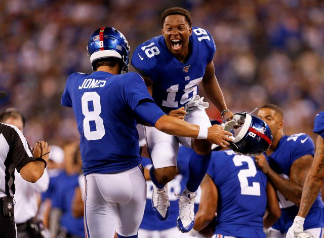 Giants wide receiver Bennie Fowler (18) and quarterback Daniel Jones (8) celebrate after a touchdown during Friday night's preseason game against the Bears in East Rutherford, N.J. Associated Press