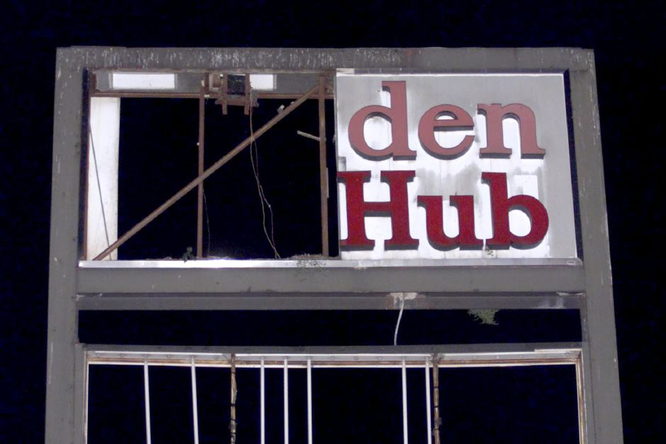 The sign for the Meriden Hub in downtown Meriden got damaged by the high winds Saturday night October 28, 2000. Meriden firefighters dismantled part of the sign in case it got lose. no copy as of Sat. night. CA