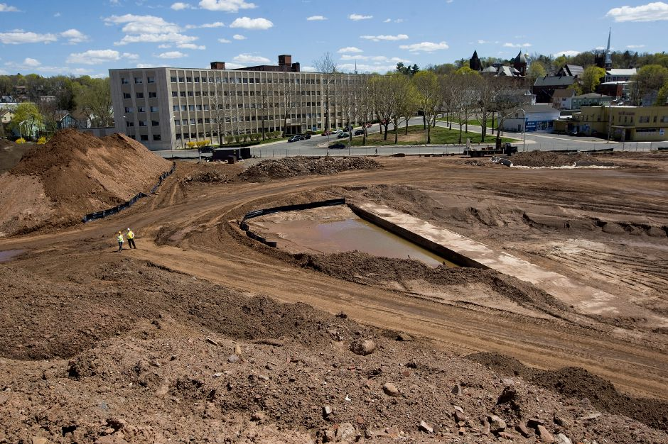 The concrete culvert of Jordan Brook is seen running diagonally toward the Kennedy building on the 14-acre Meriden Hub site Wednesday, April 29, 2015. | Dave Zajac / Record-Journal