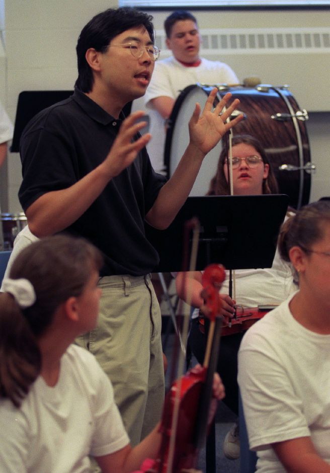 Jung-Ho Pak, music director of the New Haven Symphony Orchestra, speaks to a group of young musicians at the Wallingford SUmmer Arts Camp at Moran Middle School July 15, 1999.