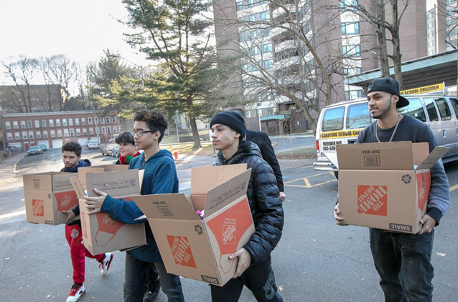 Venture Academy students, left to right, Ricky Adorno, 16, Christian Guerrero, 11, Eric Marrero Garcia, 14, Elias Medina, 17, and Kevin Cruz, 18, carry boxes of donated blankets, gloves and hats to Shelter Now on St. Casimir Dr. in Meriden, Thurs., Dec. 20, 2018. Venture Academy is an alternative education program for high school students and a College and Career Readiness Center. The event was made possible through the cooperative efforts of David Gollsneider and Shawnna Diano from Venture Academy and Lisa Teodosio from Master's Manna. Wallingford based Berntsen Electric LLC made a generous contribution to the blanket, hat and glove drive. Dave Zajac, Record-Journal
