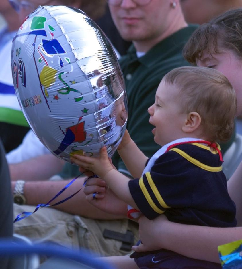 Nathan Boesel, 13-months-old, laughs at his reflection in a mylar balloon at Wilcox for the graduation of his cousin, Adam Bellone of the Electrical class Fri., June 18, 1999.