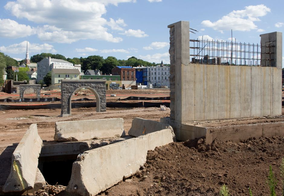 View of the Hub site from State Street in downtown Meriden, Friday, July 31, 2015. A pedestrian bridge that stretches over the park from Pratt Street to State Street is nearing completion. Concrete and steel supports built into the park will help carry the open-air bridge. | Dave Zajac / Record-Journal