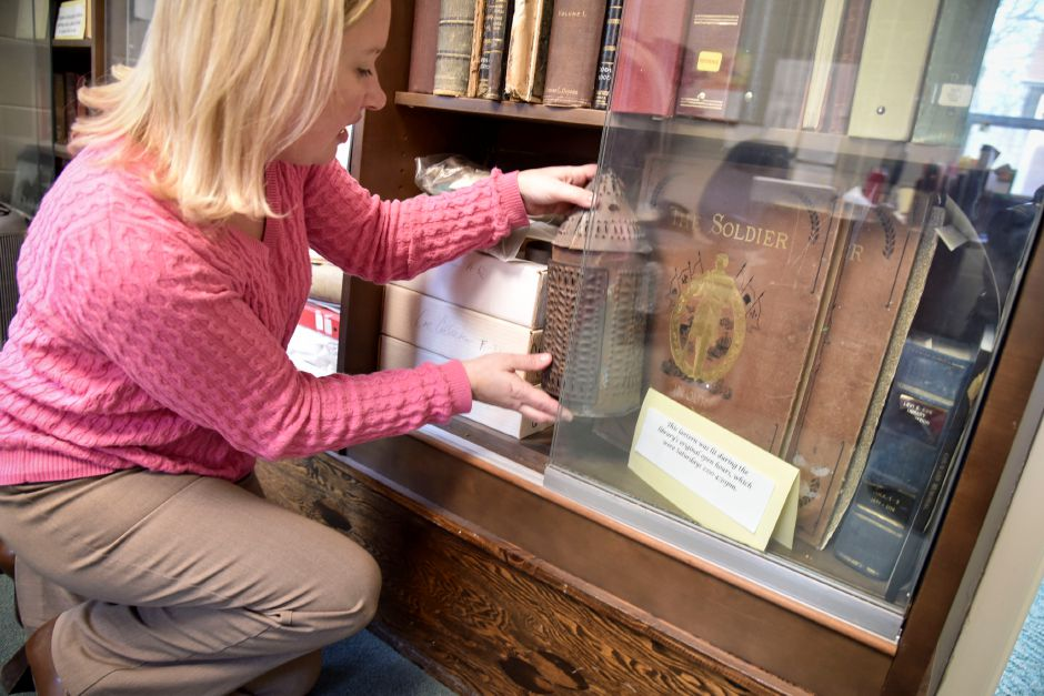 Director of the Levi E. Coe Library, Jessica Lobner, shows off the lantern that the first librarian used to signal they were open, on Nov. 14, 2018. The public library celebrated 125 years this year. | Bailey Wright, Record-Journal