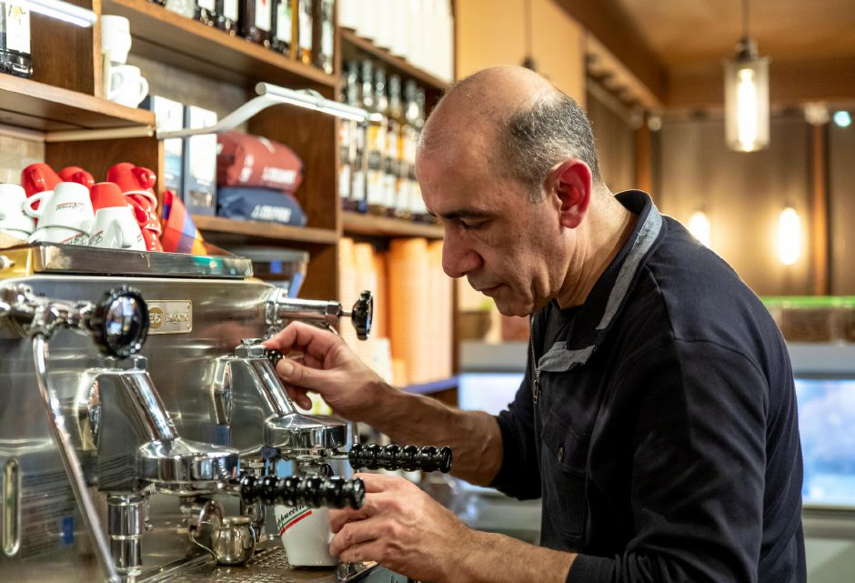 Tigran Hovhannisyan, of Berlin, makes a coffee at his newly opened cafe Busy Bean Coffee on Main Street. The cafe opened on Feb. 4. | Devin Leith-Yessian, The Citizen