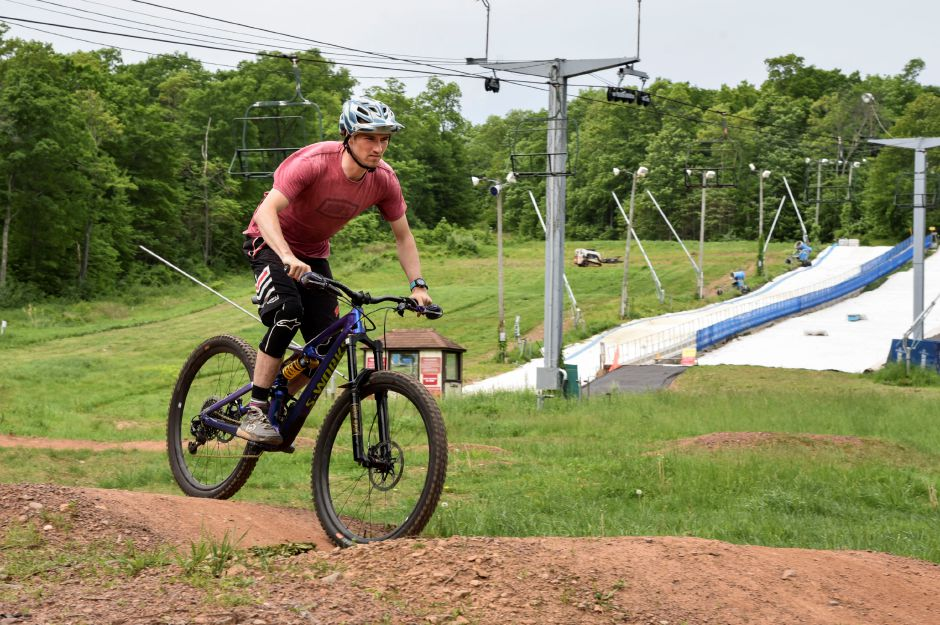 Powder Ridge Trail Team member Jordan Newth bikes on the beginner skills course at the mountain resort in Middlefield on May 28, 2019. The ski resort opened their mountain biking trails over Memorial Day weekend. | Bailey Wright, Record-Journal