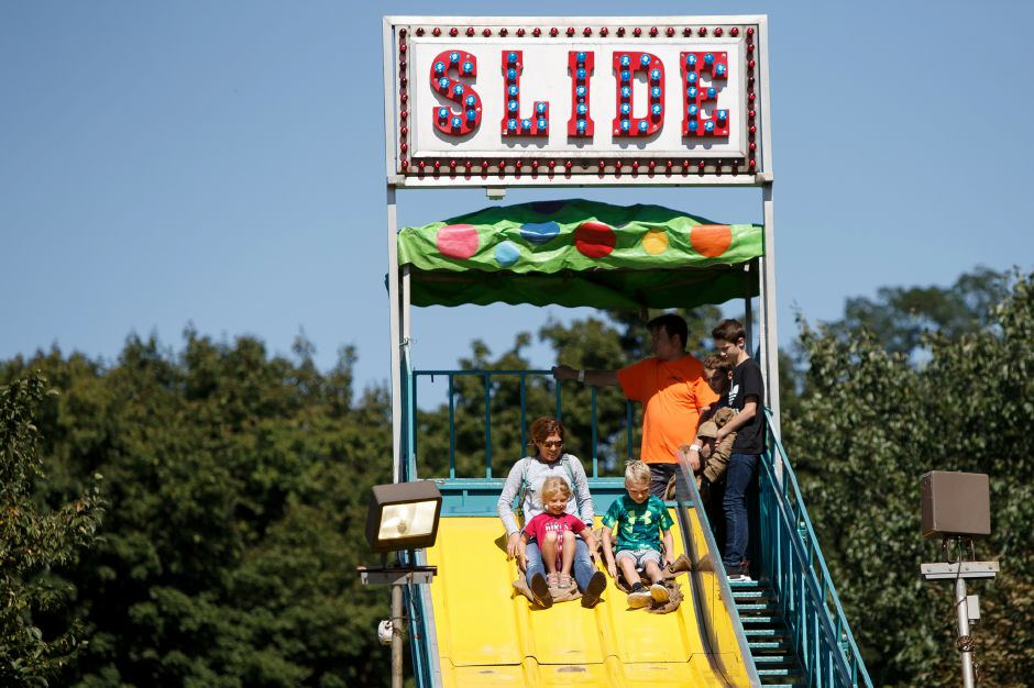 Martha Rogers takes son Jack Parzych 8 and daughter Edie 5 for a ride on the Super Slide Saturday during the Southington Apple Harvest Festival in Southington September 29, 2018 | Justin Weekes / Special to the Record-Journal