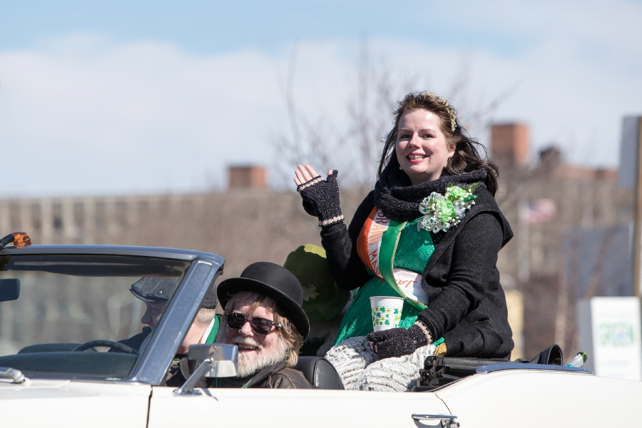 Grand Marshal Rachel Williams waves to the crowd Saturday during the 46th annual St. Patrick