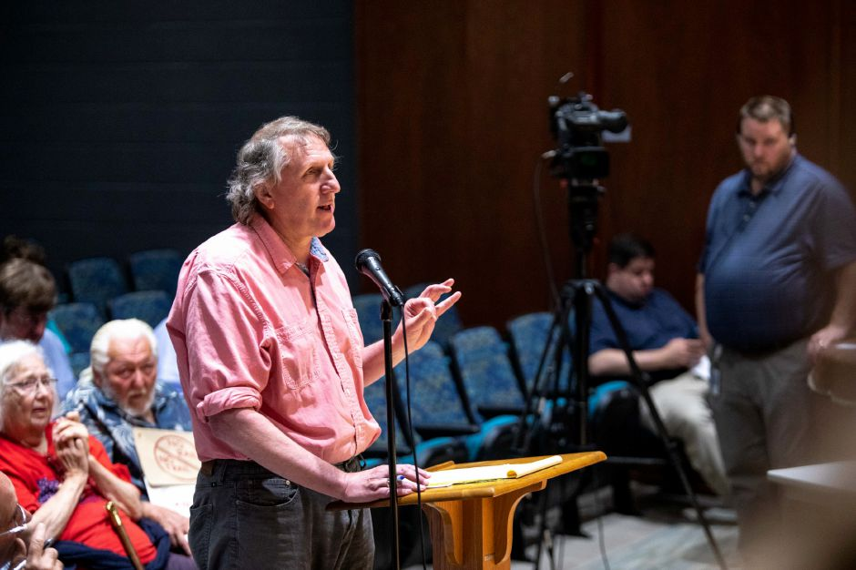 Paul Zagorski, New Britain resident and member of Protect our Watersheds CT, spoke in opposition of the Tilcon Connectcut proposal to expand their Plainville quarry at a public hearing held at Gaffney Elementary School in New Britain on June 26, 2018. | Devin Leith-Yessian/Record-Journal