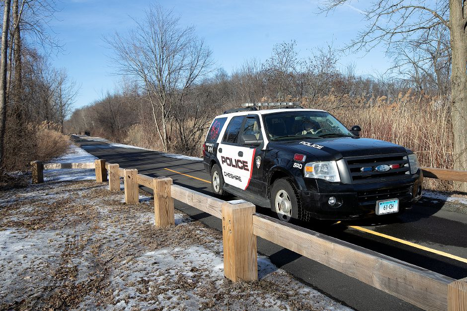 "Police investigate an ""untimely death"" on the Farmington Canal Heritage Trail near Schoolhouse Road in Cheshire, Tues., Feb. 19, 2019. Dave Zajac, Record-Journal"