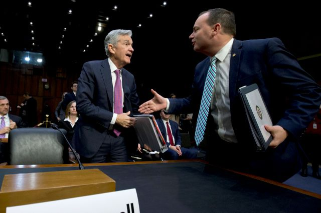 Federal Reserve Board Chair Jerome Powell shake hands with Chairman of the Congress Joint Economic Committee Sen. Mike Lee, R-Utah, during the hearing on the economic outlook, on Capitol Hill in Washington, on Wednesday, Nov. 13, 2019. (AP Photo/Jose Luis Magana)