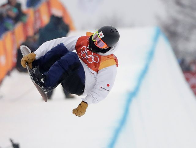 Ayumu Hirano, of Japan, jumps during the men