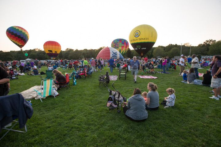 Hot Air Balloons begin to inflate for the balloon glow Friday during the Plainville Fire Company 33rd Annual Hot Air Balloon Festival at Norton Park in Plainville Aug. 25, 2017 | Justin Weekes / For the Record-Journal