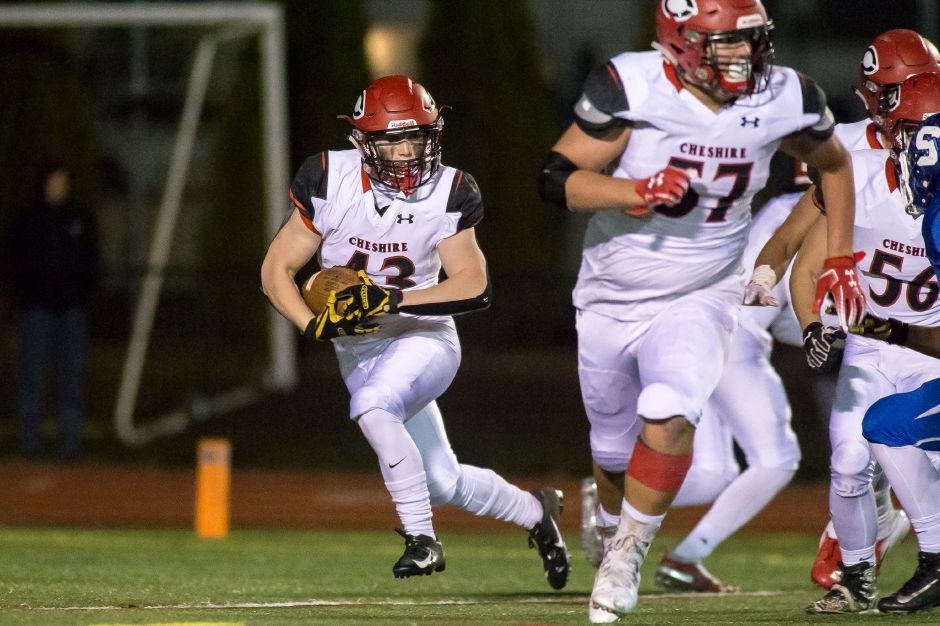 Jake McAlinden ran for three touchdowns in Cheshire's season-opening 35-14 win over Hillhouse on Friday night at Alumni Field. | Justin Weekes / Special to the Record-Journal