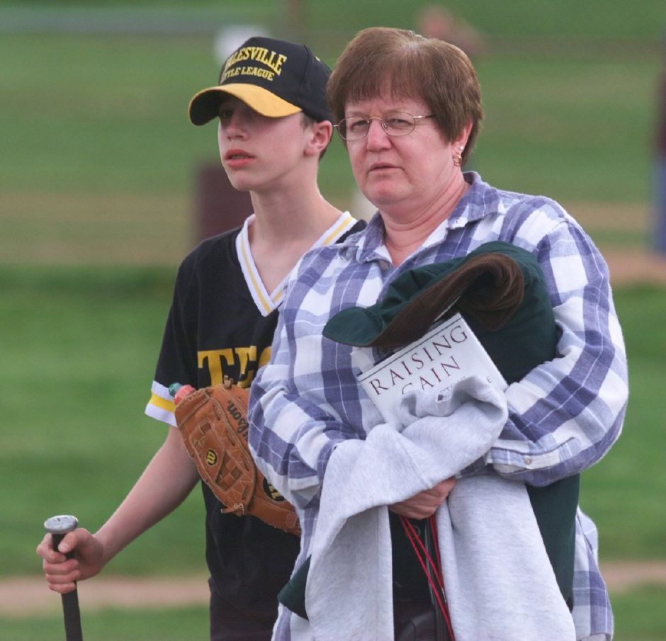 Marsha Moreno arrives at Keller Field with her son Kason, a 12-year-old who plays for the Tech Circuits team in the Yalesville Little League, May 1999.