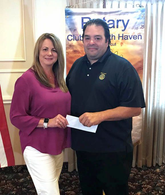 Rotary President Ron Bathrick with Wendy Marinelli of Project Graduation.