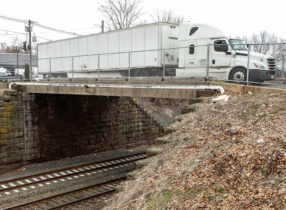 A tractor-trailer travels over the John Street bridge in Wallingford on Friday.