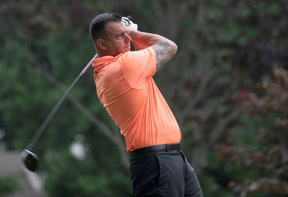 Brian Wilkinson, of Meriden, belts a drive down the 17th fairway.
