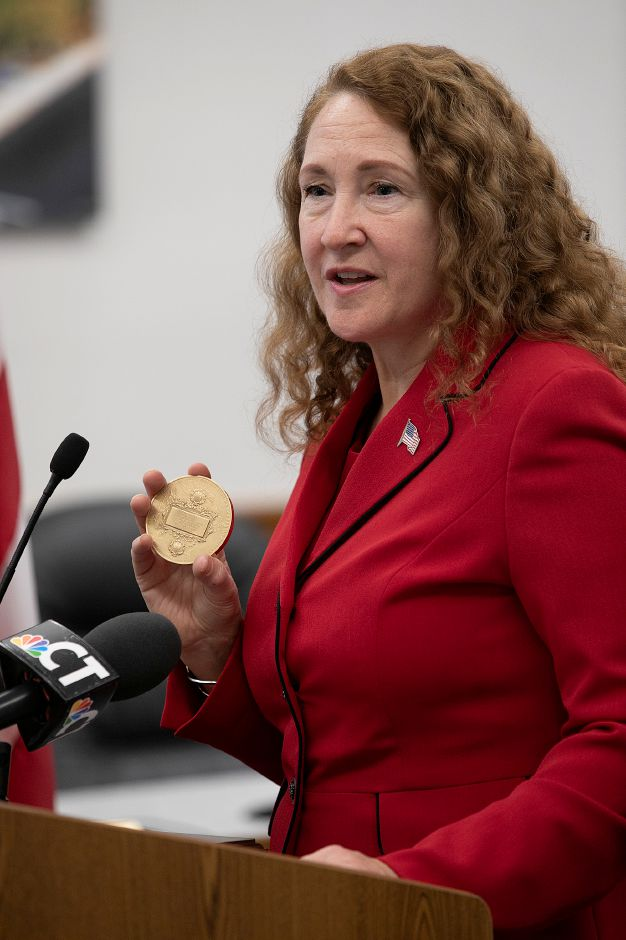 Congresswoman Elizabeth Esty (CT-5) holds the Carnegie Medal while speaking during a ceremony in honor of Jay Agli at Meriden City Hall, Mon., Nov. 19, 2018. Agli passed away in June 2017, when he selflessly dove into water at Haddam Meadows State Park in order to save his sister and one of her friends who had been swept into a rapidly-moving current. The Carnegie Medal was presented to the family of Jay Agli during the ceremony. Dave Zajac, Record-Journal