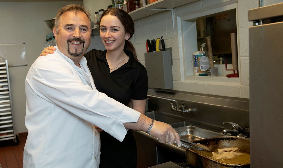 Mustafa Beskovic and daughter-in-law Albina Beskovic pose in the kitchen of the new Violi's II at Wallingford Country Club, Thurs., May 30, 2019. Violi's II restaurant caters to club members but also the public for lunch and dinner. Dave Zajac, Record-Journal