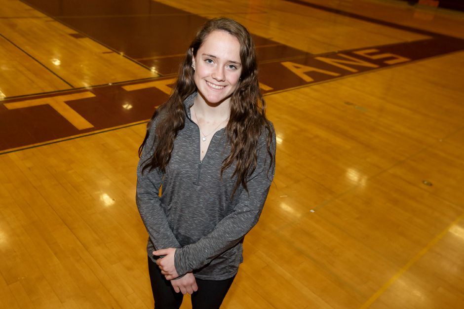 Sheehan senior Stephanie Phoenix tied her school record and won the Class M state championship in girls pole vaulting when she cleared 10 feet, 6 inches on her final jump. | Justin Weekes / Special to the Record-Journal