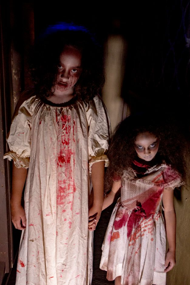 Olivia Donis, 13, left, and Amelia Donis, 8, get ready for the Haunt on Eden haunted attraction at Mount Southington, Oct. 3, 2018. | Richie Rathsack, Record-Journal