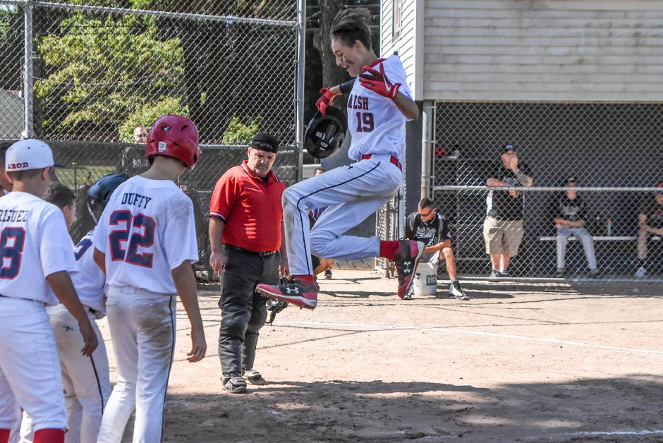 Zach Burdacki of Ed Walsh Little League launches himself onto home plate after hitting a three-run home run against South Meriden in a City Series pool game Saturday at Habershon Field. Ed Walsh and South Meriden, having eliminated defending champ Jack Barry, meet in a best-of-three championship series starting Wednesday night at Haberson. | Jim McGovern / Special to the Record-Journal
