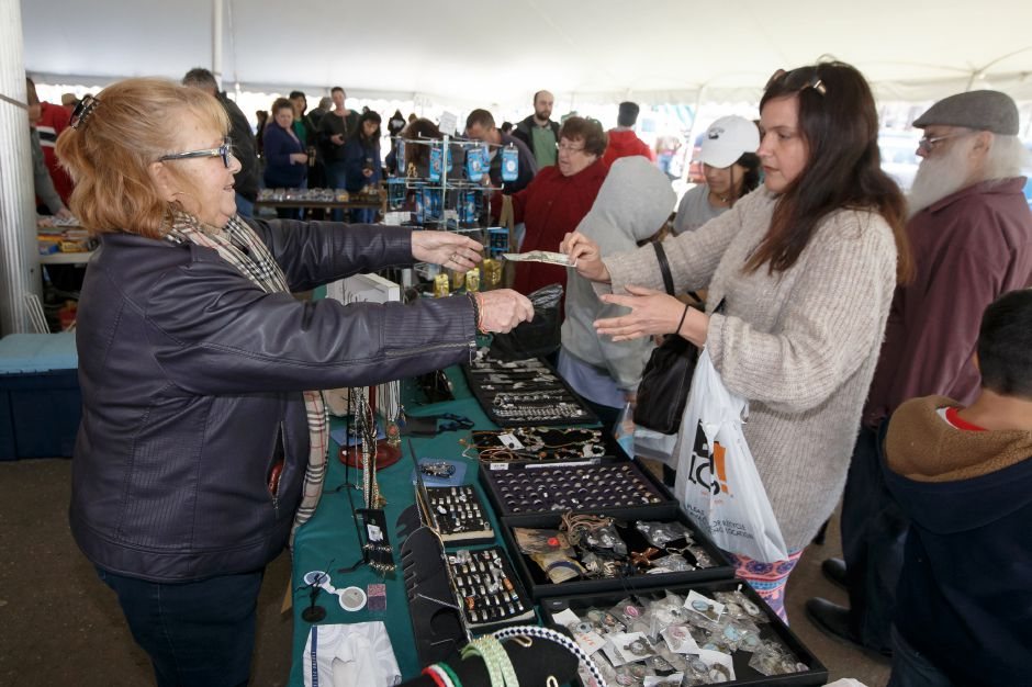 Jessica Paul, of Middlebury, handles a purchase from Southington's Connie Palazzo, left, in the tag sale tent  during last year's tag sale in Hubbard Park.