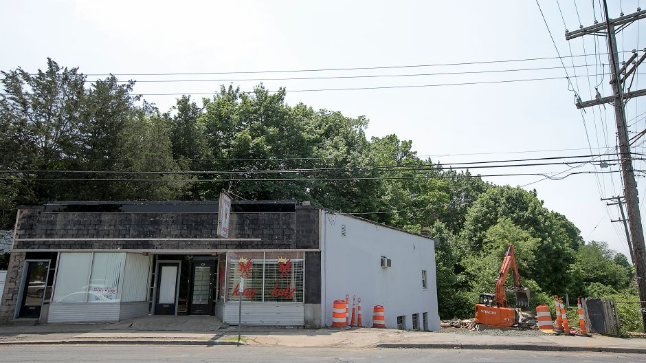 Crews continue demolition of the former Bradley Diner, right, on West Main Street in Meriden, Friday, May 25, 2018. The building was razed to make way for rebuilding the Sodom Brook Bridge on West Main Street. Dave Zajac, Record-Journal