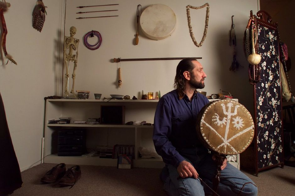 RJ file photo - Gregory Besek, a shaman, holds a drum from Nepal in his healing room at his Branford office. Besek will give a talk at the Meriden library on Shamanism, Feb. 1999.