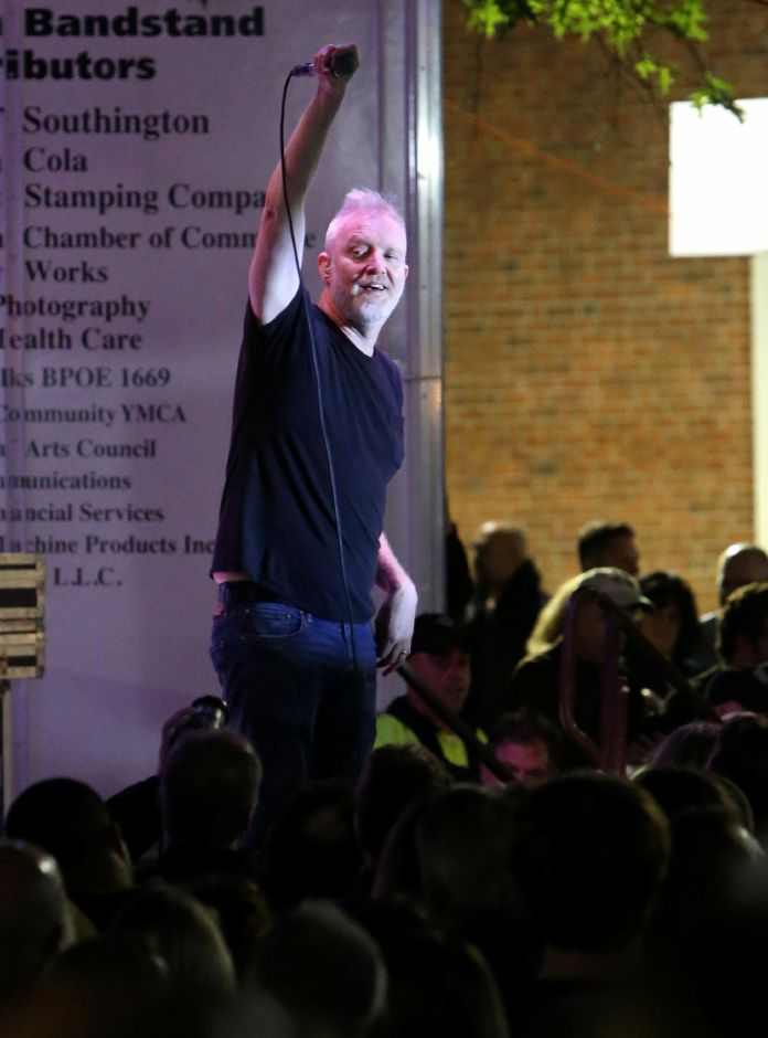 Spin Doctors lead singer Chris Barron does a call-and-response with the crowd during the concert on the main stage at the annual Apple Harvest Festival in Southington on Saturday, Oct. 12, 2019. Emily J. Tilley, special to the Record-Journal.