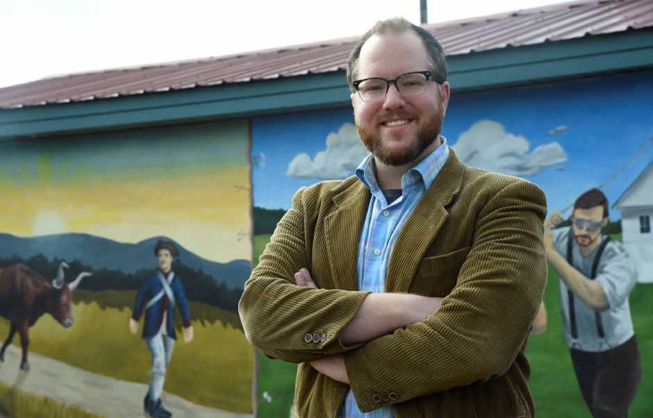 Durham native and Middlefield resident Mike Golschneider poses with the mural he painted at Allyn Brook Park in Durham, on April 6, 2019. | Bailey Wright, Record-Journal