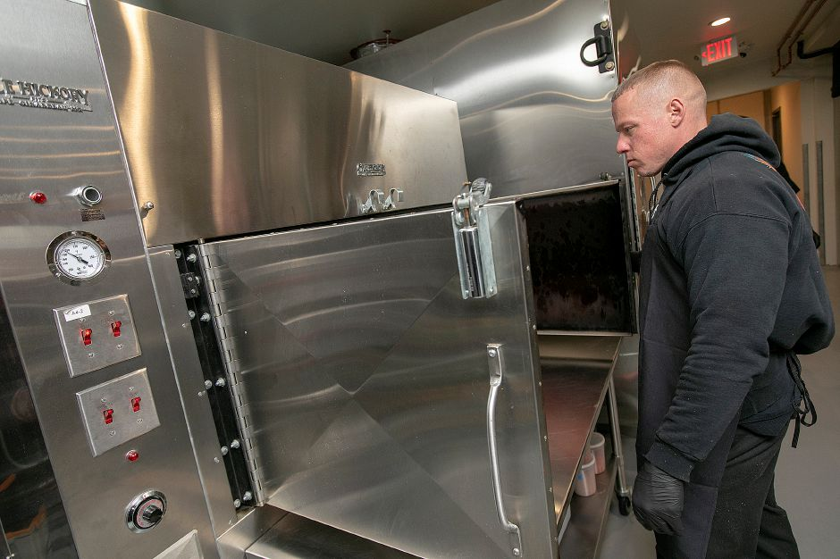 Head Chef Van Hurd looks over a smoker as preparations continue for the opening of Taino Prime Smokehouse on East Main Street in Meriden on Tuesday. The restaurant opens today at 11:30 a.m.