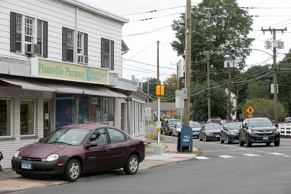 A  vehicle is parked in front of Plantsville Pharmacy on Thursday.Dave Zajac, Record-Journal