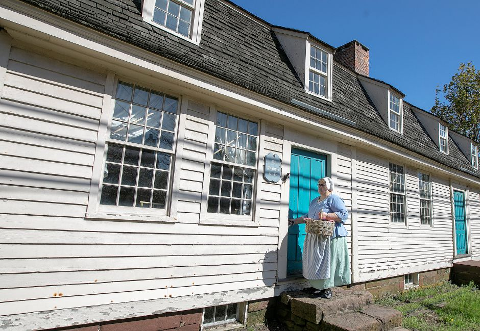 Curator Karen Keene enters the 1711 Solomon Goffe House in colonial dress, Mon., May 6, 2019. The English Gambrel roofed house is the oldest in Meriden and listed on the National Register of Historic Places. Dave Zajac, Record-Journal