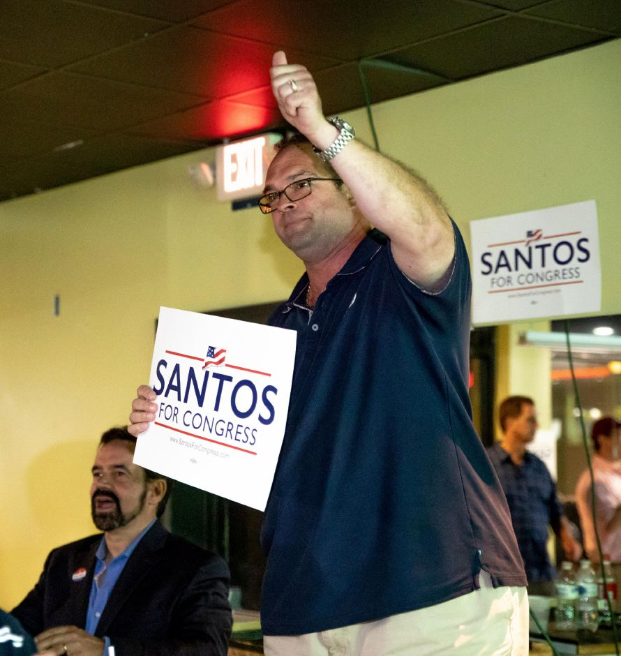 Campaign volunteer Joseph Feest announces that Republican Manny Santos won the primary to be the party