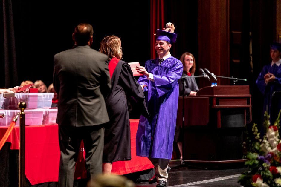 A student receives his diploma during the Berlin High School graduation cermony, held at Central Connecticut State University on June 16, 2019. | Devin Leith-Yessian/Record-Journal
