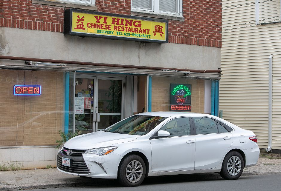 A parked vehicle in front of Yi Hing Chinese Restaurant in downtown Plantsville, Thursday, Sept. 13, 2018. A project that'll include wider sidewalks, narrower roads and aesthetic upgrades in downtown Plantsville took a step forward with the hiring of a design firm. Dave Zajac, Record-Journal