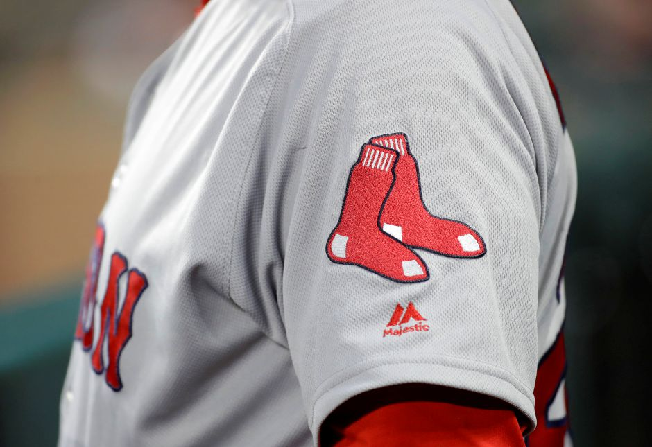 The Boston Red Sox logo is seen on first base coach Ruben Amaro Jr