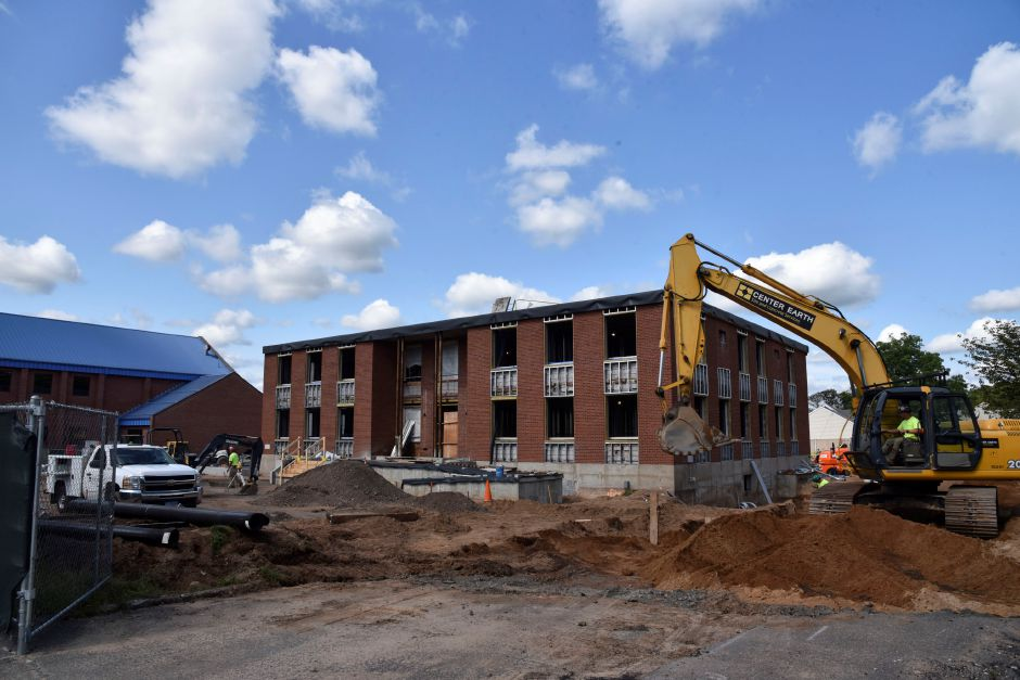 Construction crews work on renovating the North Haven police station at 8 Linsley St. on Thursday, Sept. 20. The construction's completion date has been pushed back more than two months, to late April 2019. | Bailey Wright, The Citizen