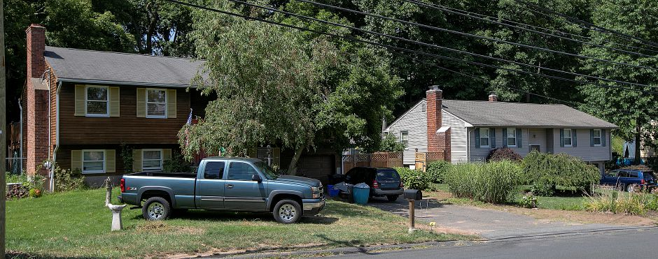 115 Allen Ave., left, and 107 Allen Ave., right, in Meriden, Mon., Aug. 12, 2019. Police are investigating at 115 and 107 Allen Ave. after a fatal shooting stemming from an incident in the driveway of 115 Allen Ave. Dave Zajac, Record-Journal